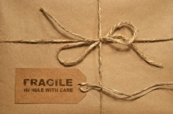 Brown shipping parcel tied with twine and tag for copy space